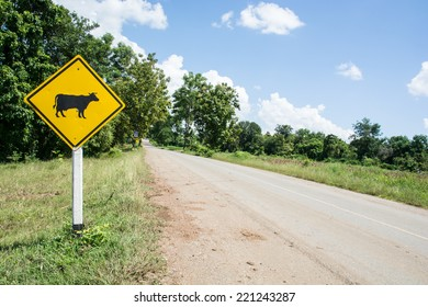 Warning signs of animals. the yellow animal warning sign with cow in it.