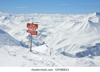 warning signs of avalanche on the slopes of the mountain in winter