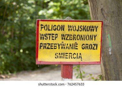 The warning signs at the entrance to the military zone in Poland. No entry.