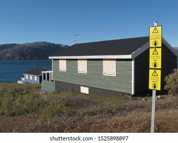 Warning Signs and locked houses, Grønnedal, Southwest Greenland