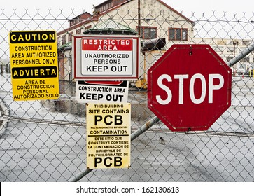 Warning signs outside hazardous industrial site