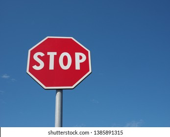 Warning signs, stop traffic sign over blue sky