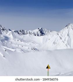 Warning sing on ski slope. Caucasus Mountains, Georgia, Gudauri