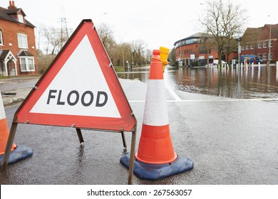Warning Traffic Sign On Flooded Road