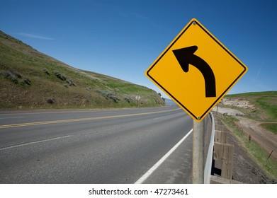 Warning turn left traffic sign
