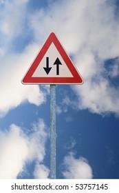 Warning two way road sign