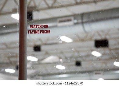 Warning to watch for flying pucks at an ice hockey rink