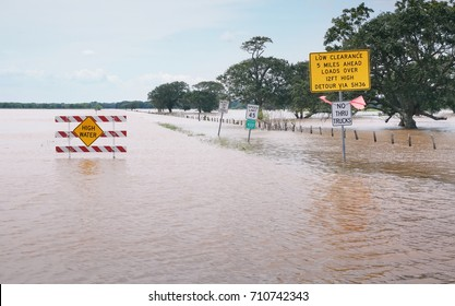 Warnings about high water signs on a flooded road in Texas. The aftermath of Hurricane Harvey, USA