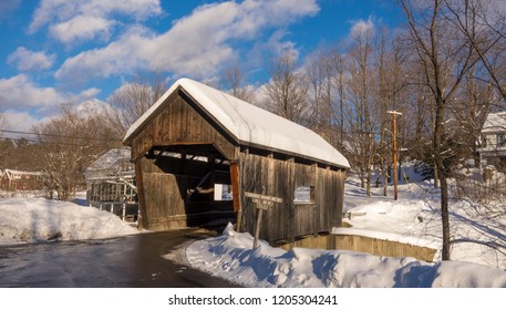 WARREN, VERMONT, USA - JANUARY 1, 2013: Covered bridge over Mad River.
