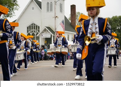 Warrens, Wisconsin / USA - September 29th, 2019: Wisconsin's Cheese head high school marching band of Mauston, Wisconsin marched in Warrens Cranberry Festival Parade.