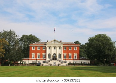 WARRINGTON, UK - AUGUST 23, 2015: Warrington Town Hall, Cheshire, England. The Town Hall, flanked by two detached service wings at right angles to the house, is a Grade I listed building