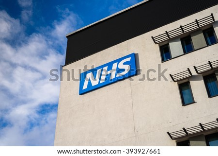 WARRINGTON, UK - MARCH 6, 2016: View of the NHS (National Health Service)  logo at the Springfields Medical Centre in the centre of Warrington, Cheshire.
