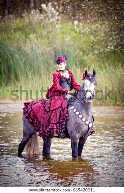 Warrior Equestrian Princess in a Red Dress