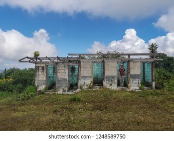 Warrior man being the target shooting in abandoned building with amazing cloudy sky background
