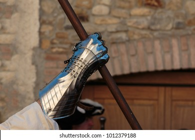 Warrior with Medieval Metallic Mitten for Hands Protection and Wooden Stick.