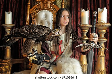 Warrior Princess with eagle and sword on the throne
