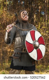 Warrior viking in the autumn forest.