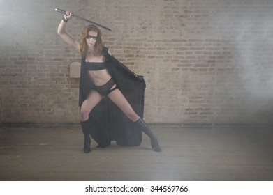 warrior woman hold sword and wearing leather dress and and leather bra and panties.