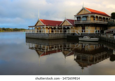 WARRNAMBOOL, VICTORIA, AUSTRALIA - 31 JULY 2019: The historic Proudfoots Boatshed on the Hopkins River is an iconic tourist attraction in seaside Warrnambool.