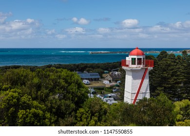 Warrnambool, Victoria, Australia - December 24 2017: The historic Lady Bay Lower Lighthouse, built in 1854, at Flagstaff Hill. It is still in use with a fixed light with red and green sectors.