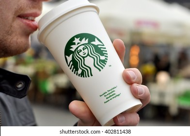 WARSAW - APR 08: An Unidentified man holding a cup of beverage from Starbucks cafe in Warsaw on April 08. 2016 in Poland.