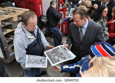 WARSAW - APRIL 11: Distribution of special editions newspapers, on the day after of the plane crash, that killed Poland's president, Lech Kaczynski. April 11, 2010 in Warsaw, Poland.