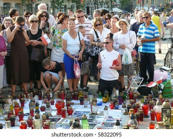 WARSAW - AUGUST 1: Protesters in front of Presidential Palace on August 1, 2010 in Warsaw, Poland. People fight to keep cross there as symbol of mourning after president Kaczynski plane crash in April