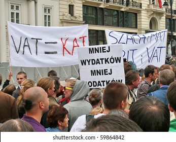 WARSAW - AUGUST 26: Protesters in front of Presidential Palace on August 26, 2010 in Warsaw, Poland. Supporters of Janusz Korwin Mikke gathered to protest against VAT tax increase and government