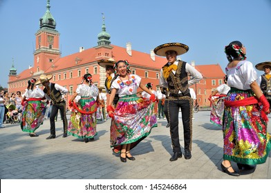 """WARSAW - AUGUST 27: Dancers of folklore ensemble """"VALLARTA AZTECA"""" from Mexico - street parade during the International Folklore Festival """"WARSFOLK"""" ; on August 27, 2011 in Warsaw, Poland."""