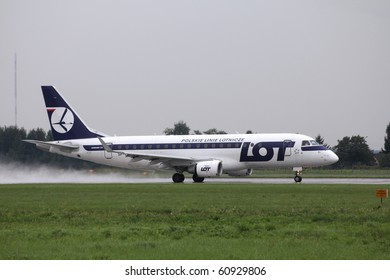 WARSAW - AUGUST 31: Embraer 175 of LOT Polish Airlines taking off on August 31, 2010 from Warsaw Chopin airport in Poland. As of 2010, Embraer 175 has a flawless safety record.