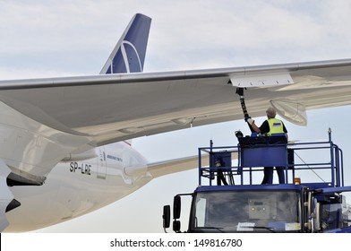 WARSAW - AUGUST 4: New Boeing 787 Dreamliner of the LOT Polish Airlines - receiving fuel from tanker truck at Chopin Airport on August 4, 2013 in Warsaw, Poland.