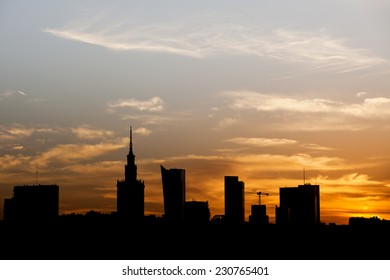 Warsaw city downtown skyline silhouette against a sky at sunset in Poland.
