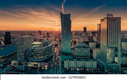 Warsaw cityscape. Panoramic view on the city buildings during the sunset in the capital of Poland.