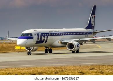 Warsaw, Frederic Chopin Warszawa Intl Airport (EPWA) / Poland - 30.03.2018: LOT Polish Airlines SP-LNA Embraer 190/195 Aircraft