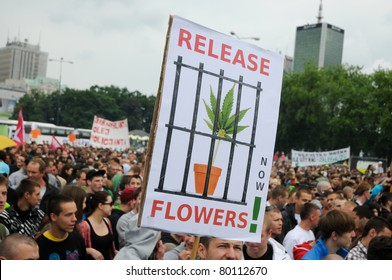 WARSAW - MAY 28: Participants of rally for cannabis soft drugs (marihuana) legalization on May 28, 2011 in Warsaw, Poland. Rally was organized by the Free Hemp Initiative and gathered 6000 people.