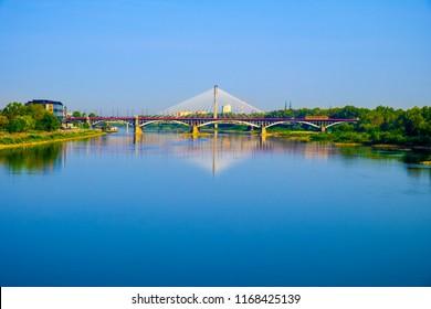 Warsaw, Mazovia / Poland - 2018/08/30: Panoramic view of the Poniatowskiego bridge and Swietokrzyski bridge across the Vistula river with Warsaw city center in background