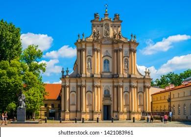 Warsaw, Mazovia / Poland - 2019/06/01: Front view of the rococo Visitationist St. Joseph Church – known as Kosciol Wizytek - at the Krakowskie Przedmiescie street in the Old Town quarter of Warsaw