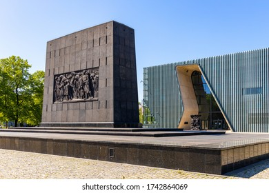 Warsaw, Mazovia / Poland - 2020/05/10: Warsaw Ghetto Heroes monument by Albert Speer in front of POLIN Museum of the History of Polish Jews in historic Jewish ghetto quarter