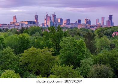 WARSAW, MAZOVIA PROVINCE, POLAND -  MAY 29, 2020: Skyline of the Warsaw center during cloudy sunset. View form the west.