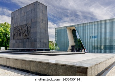 WARSAW, MAZOVIAN PROVINCE / POLAND - JUNE 23, 2019: Ghetto Heroes Monument. Warsaw Ghetto Uprising memorial. Museum of the History of Polish Jews 'Polin'. Designed by Rainer Mahlamäki.