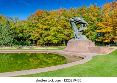 WARSAW, MAZOVIAN PROVINCE / POLAND - OCTOBER 11, 2018: Frederic Chopin statue (by Waclaw Szymanowski)  located at the Royal Baths Park.