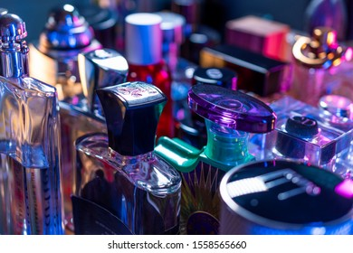 Warsaw, Mazowieckie / Poland - 11.13.2019: Fragrance perfume bottles collection in colorful light