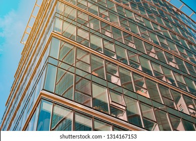 Warsaw, Poland - 01 27 2019: Glass facade of office tower Warsaw Spire in Warszawa on Towarowa Street. Glass windows in the modern office building skyscraper in the business district