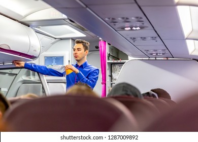Warsaw, Poland, 01.04 2019:  Air hostess demonstrate safety procedures to passengers prior to flight take off
