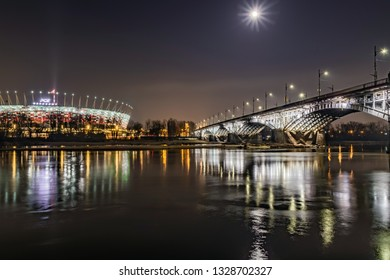 Warsaw / Poland - 02 14 2019: The National Stadium in Warsaw and the Poniatowski Bridge at night