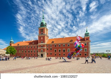WARSAW, POLAND - 05.05.2018. Royal Castle at central square of polish capital - Warsaw. many tourists visit this town in sunny day. There are many historic, old buildings surrounding square and castle