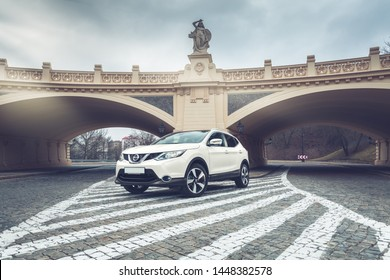 Warsaw, Poland, 09-03-2017. Nissan Qashqai in white pearl paint on streets of Warsaw city.