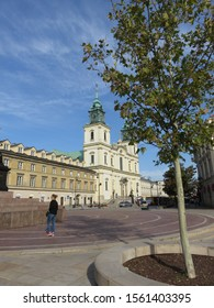 Warsaw, Poland - 09.11.2019: near the monument to Copernicus on the background of a building with a cathedral with crosses