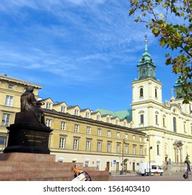 Warsaw, Poland - 09.11.2019: near the monument to Copernicus on the background of a building with a cathedral with crosses in the early morning
