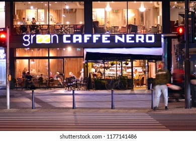 Warsaw, Poland. 10 September 2018. Sign Green Caffe Nero. Company signboard Green Caffe Nero.